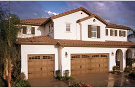 Type of door:16x7 & 8x7 Accent Cedar Model #5283 with Stamped hardware & 2-2 Piece Arched Madison Windows